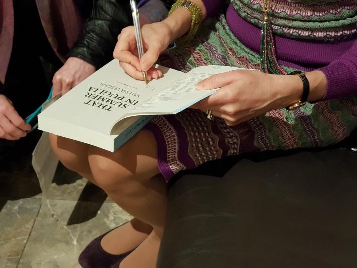 Valeria signing books